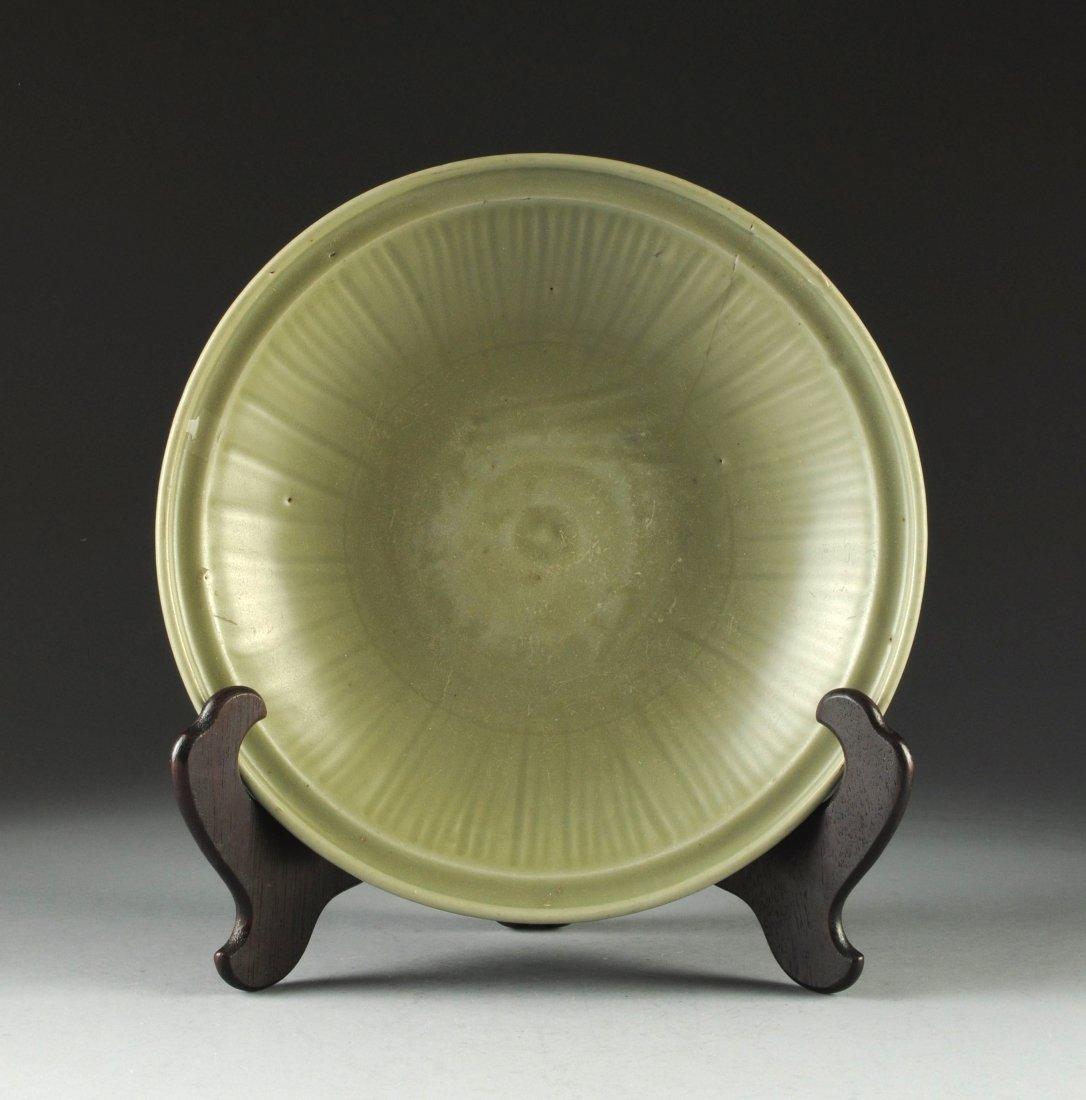 A MING DYNASTY CELADON BOWL, CH'UNG CHENG, CIRCA 1628-1