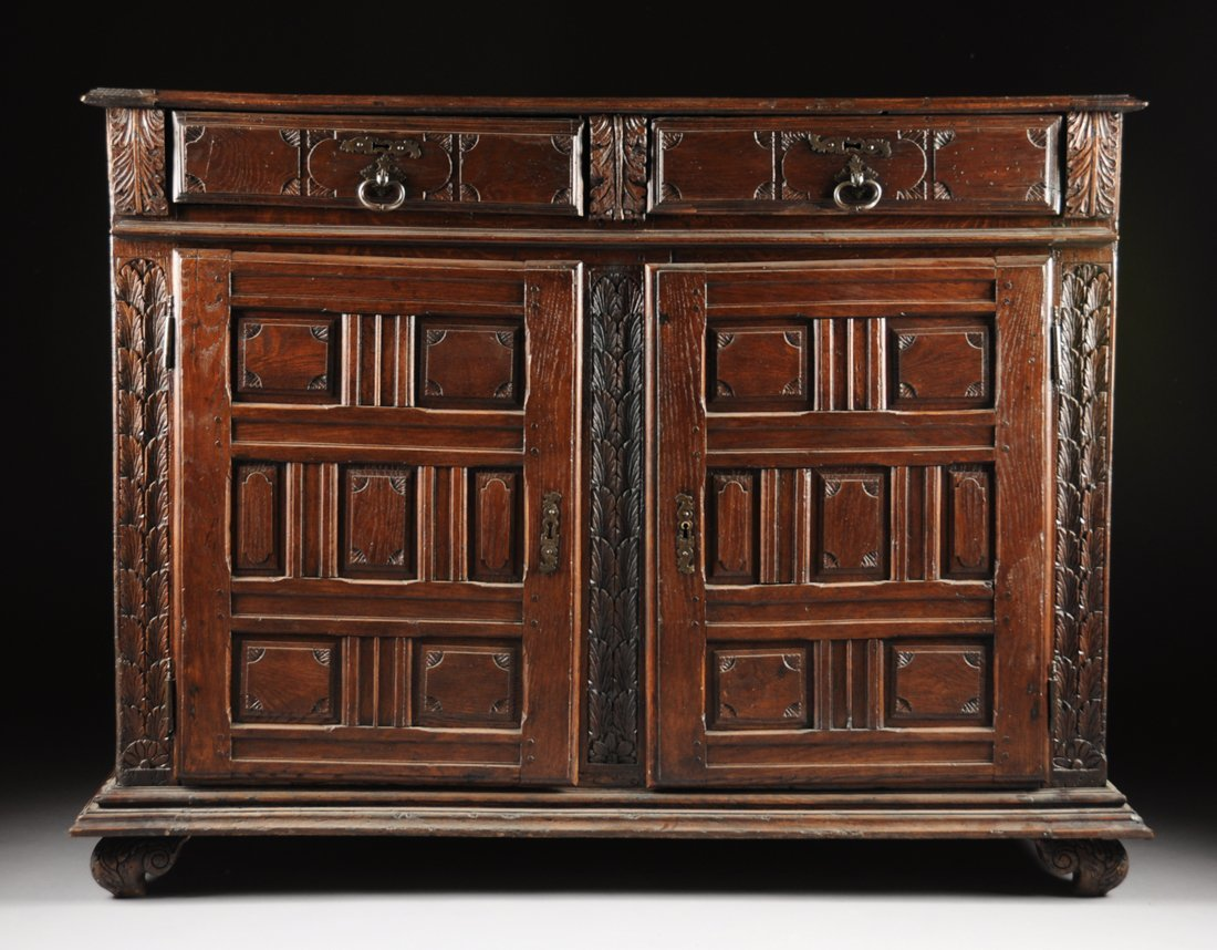 A FRENCH OAK LOW DRESSER, 18TH CENTURY, having two shor