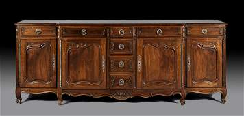 A FRENCH PROVINCIAL STYLE CARVED WALNUT BUFFET GRAND, E