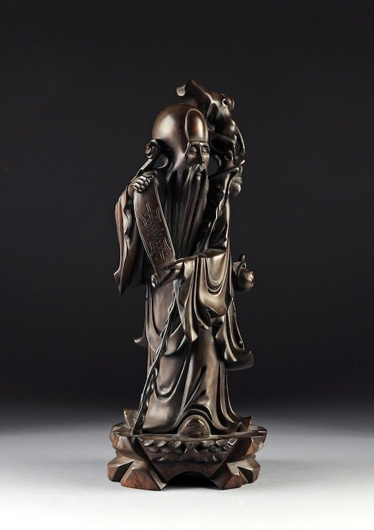 A CHINESE CARVED HARDWOOD FIGURE OF A SAGE IMMORTAL, 20