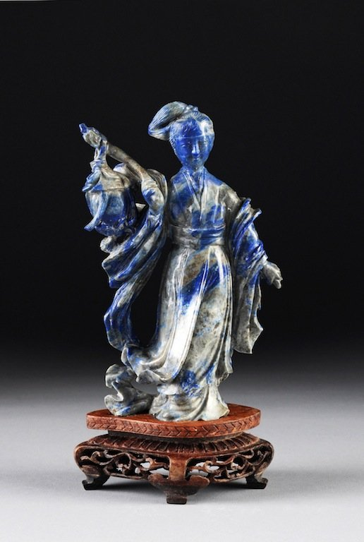A CHINESE CARVED LAPIS FIGURE OF GUANYIN ON STAND, 20TH