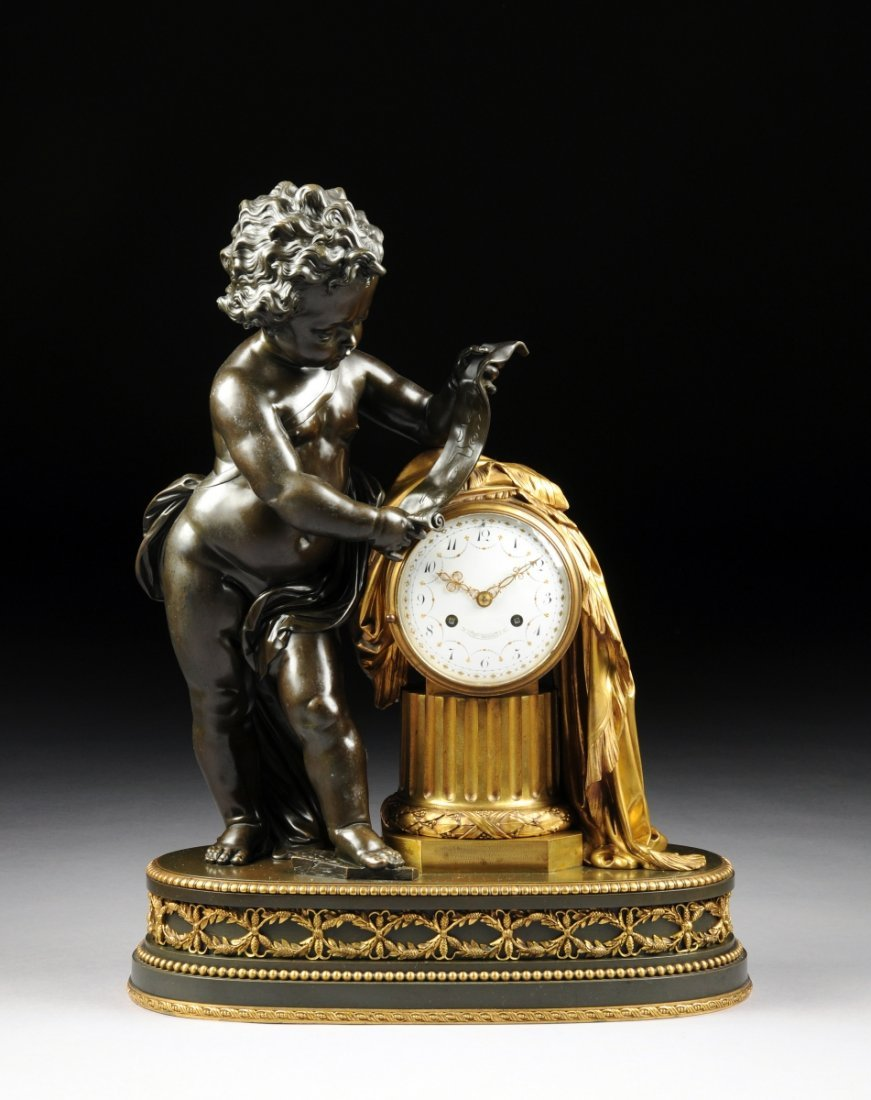 A FINE LOUIS XVI STYLE GILT AND PATINATED BRONZE FIGURA