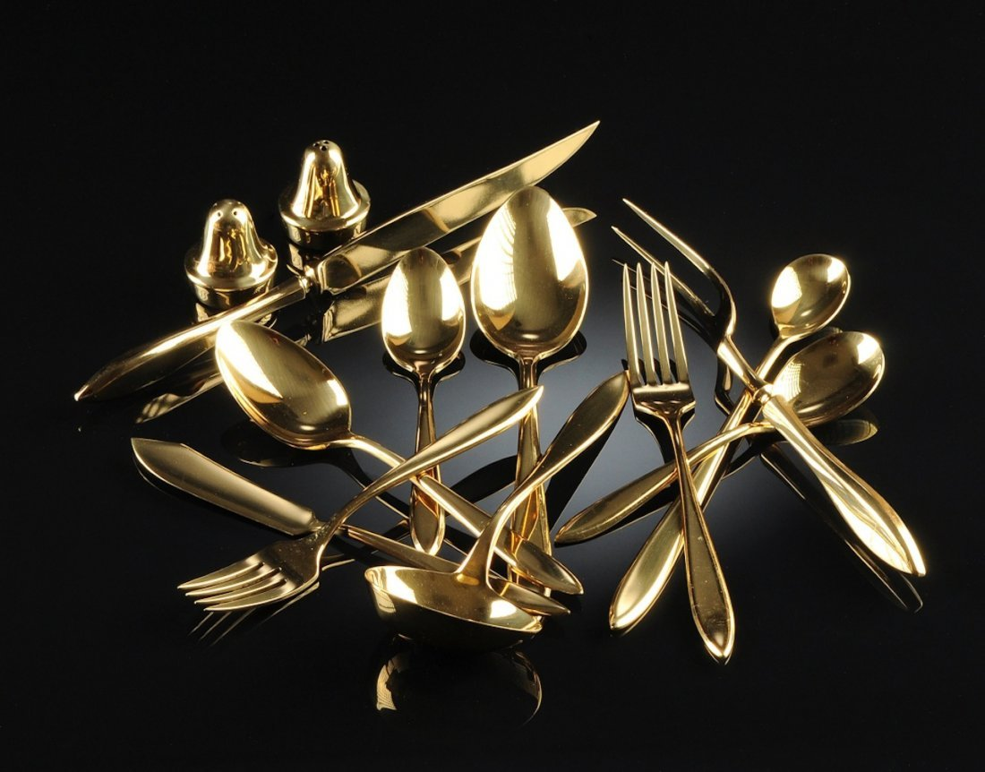 A DIRILYTE GOLD TONED FLATWARE SERVICE FOR EIGHT, 20TH