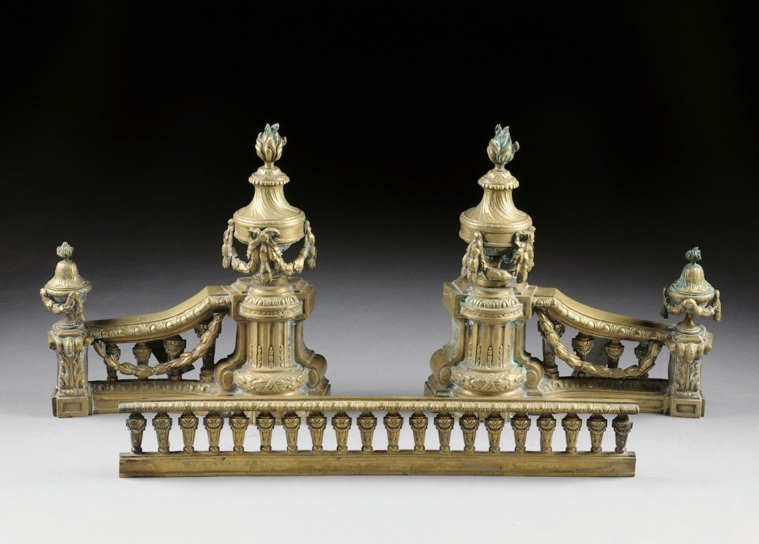 A PAIR OF LOUIS XVI STYLE CHENETS AND BALUSTRADE FENDER