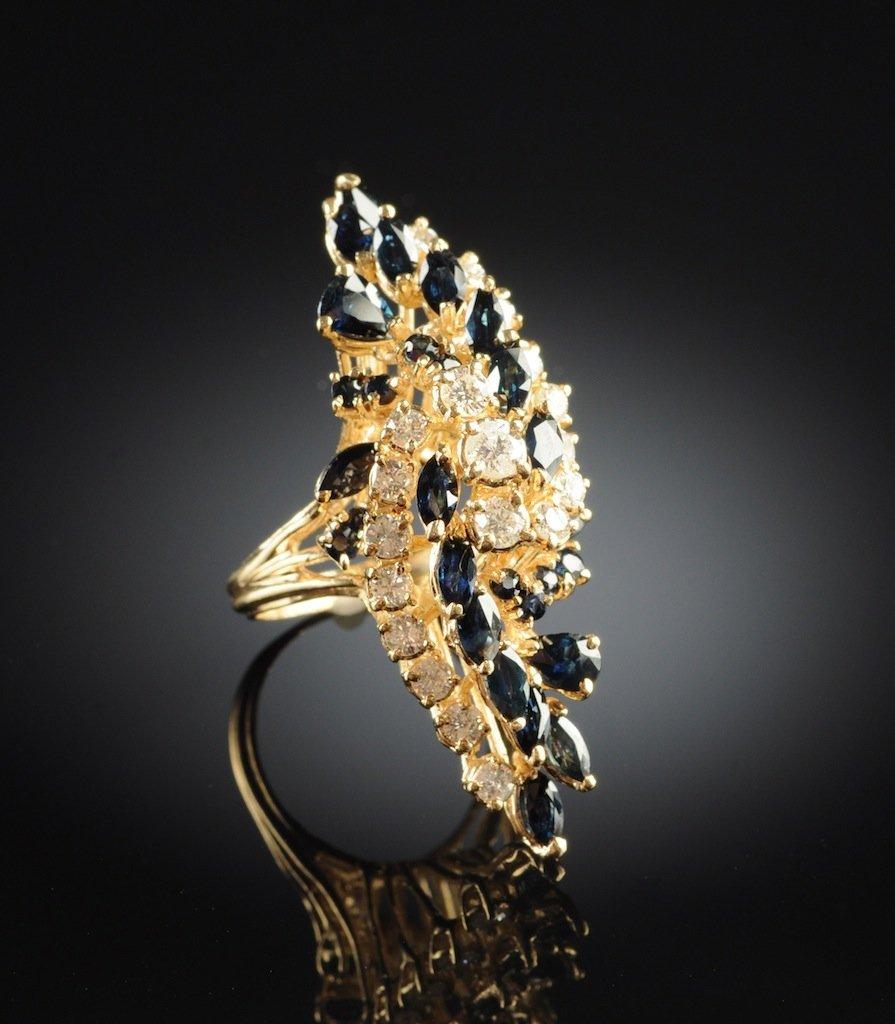 A 14K YELLOW GOLD, DIAMOND, AND BLUE SAPPHIRE LADY'S RI