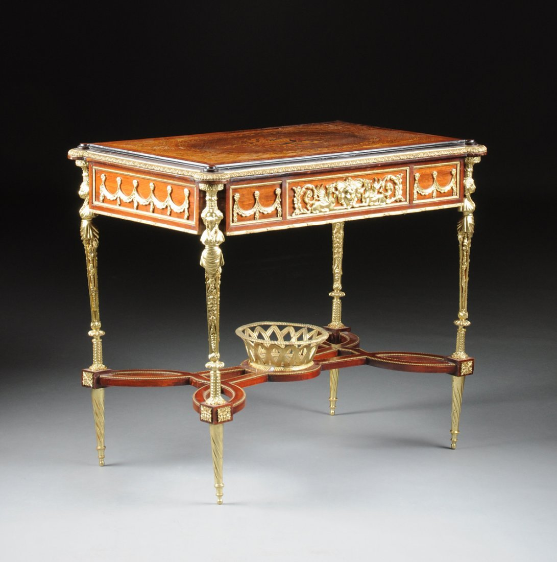 A LOUIS XVI STYLE GILT METAL MOUNTED MARQUETRY