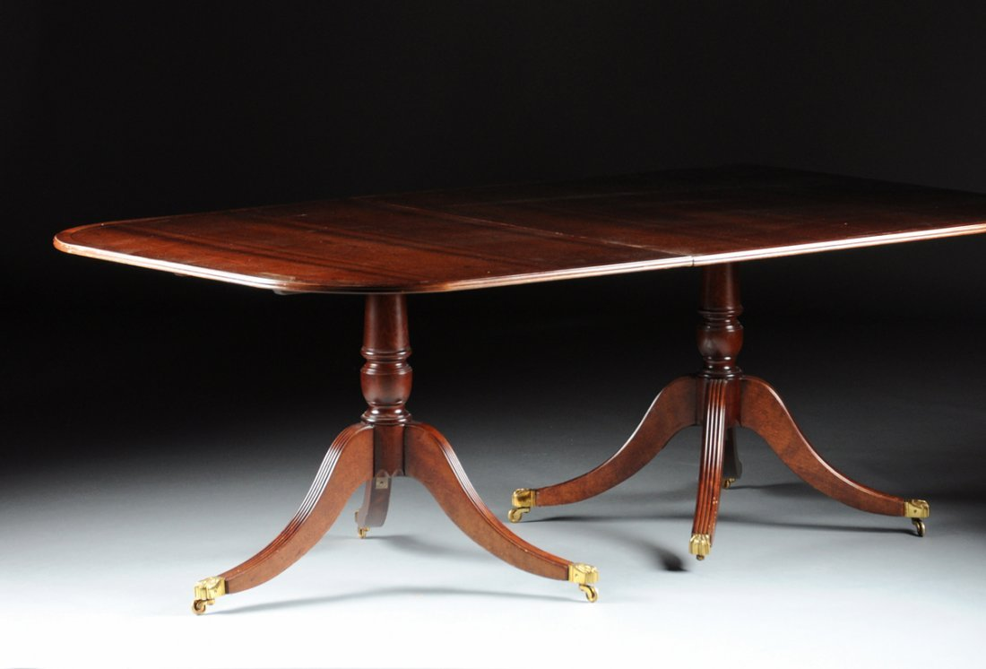 A FEDERAL STYLE MAHOGANY THREE PEDESTAL DINING TABLE,