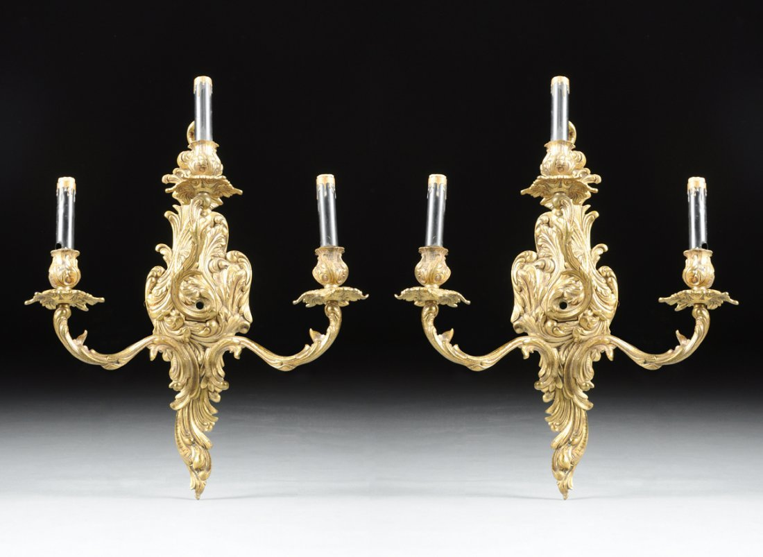 A PAIR OF LOUIS XV STYLE GILT BRONZE THREE-LIGHT WALL