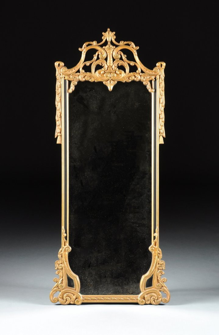 A NEOCLASSICAL STYLE CARVED GILTWOOD MIRROR, FIRST HALF