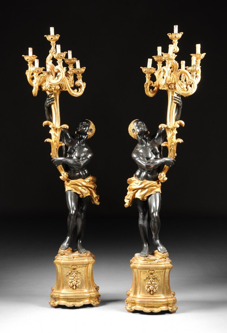 A PAIR OF VENETIAN STYLE PARCEL GILT AND EBONIZED