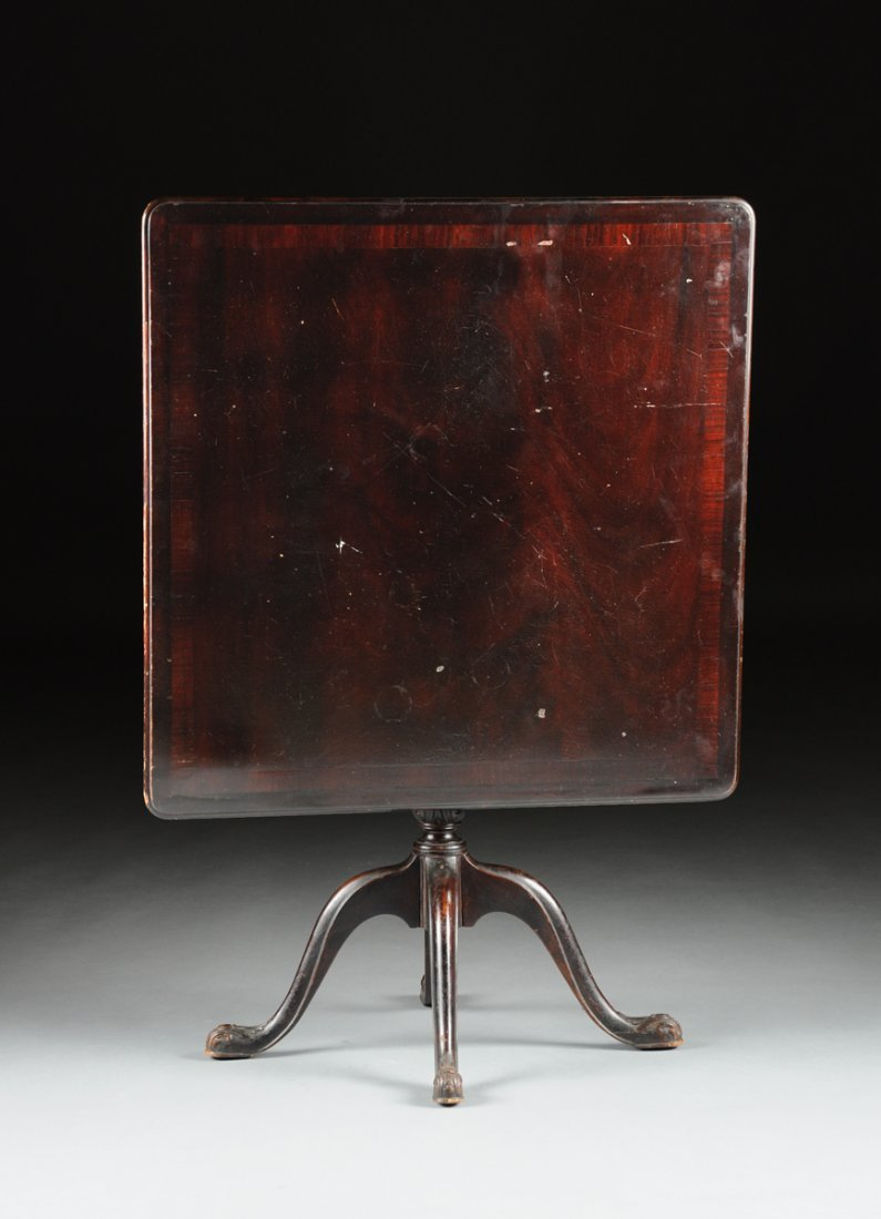 A QUEEN ANNE REVIVAL CARVED MAHOGANY TILT-TOP BREAKFAST