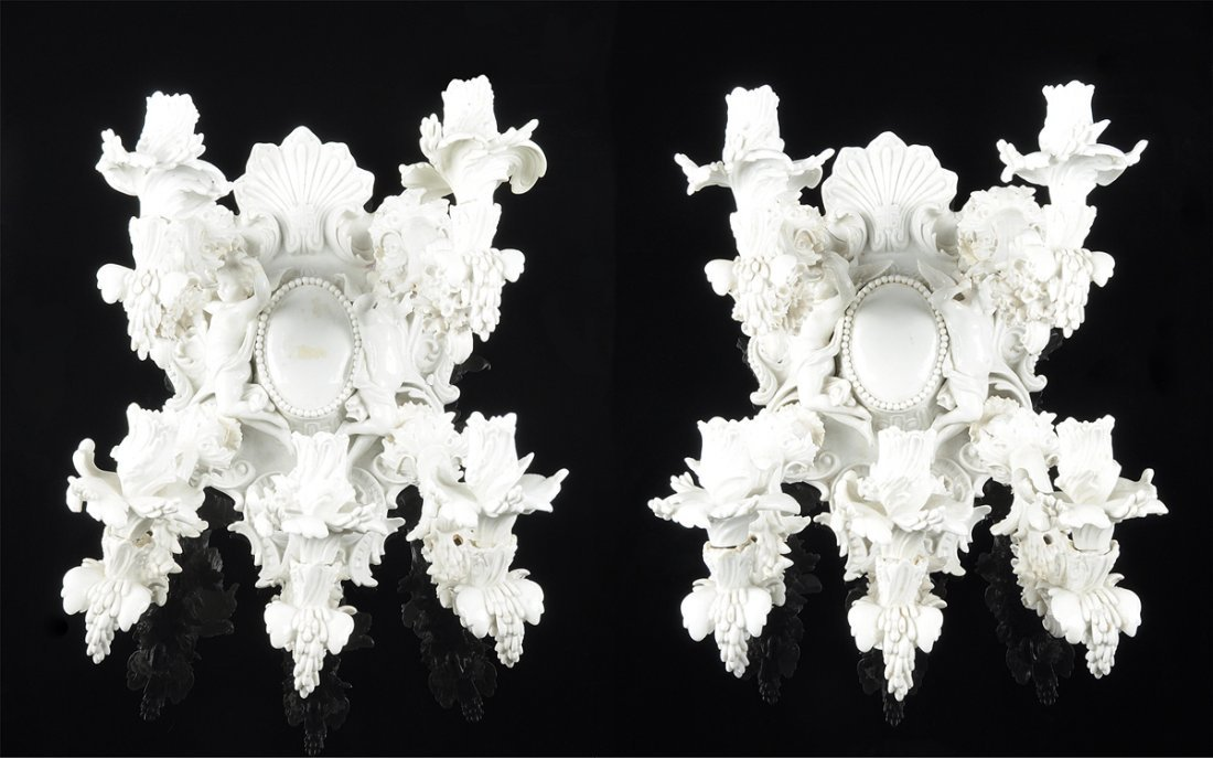 A PAIR OF ROCOCO REVIVAL WHITE PORCELAIN FIVE-LIGHT