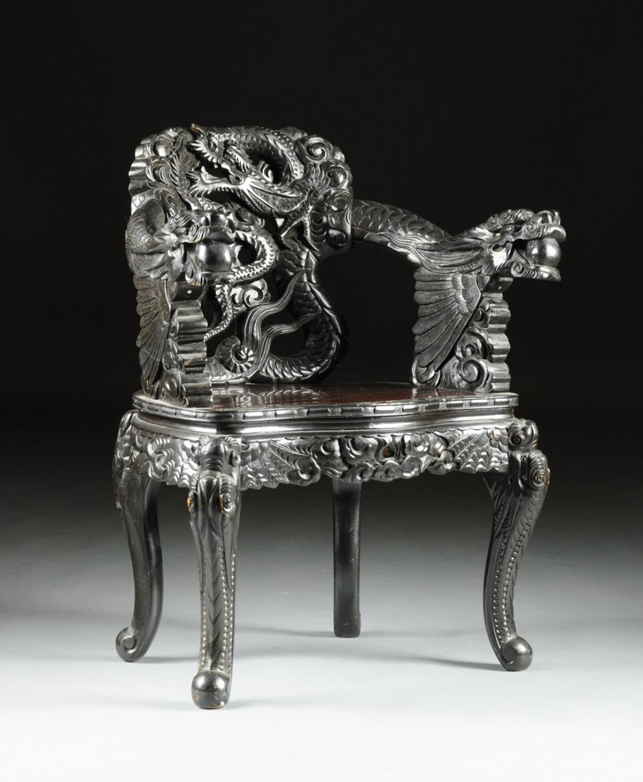 A CHINESE EXPORT CARVED HARDWOOD ARMCHAIR, POSSIBLY
