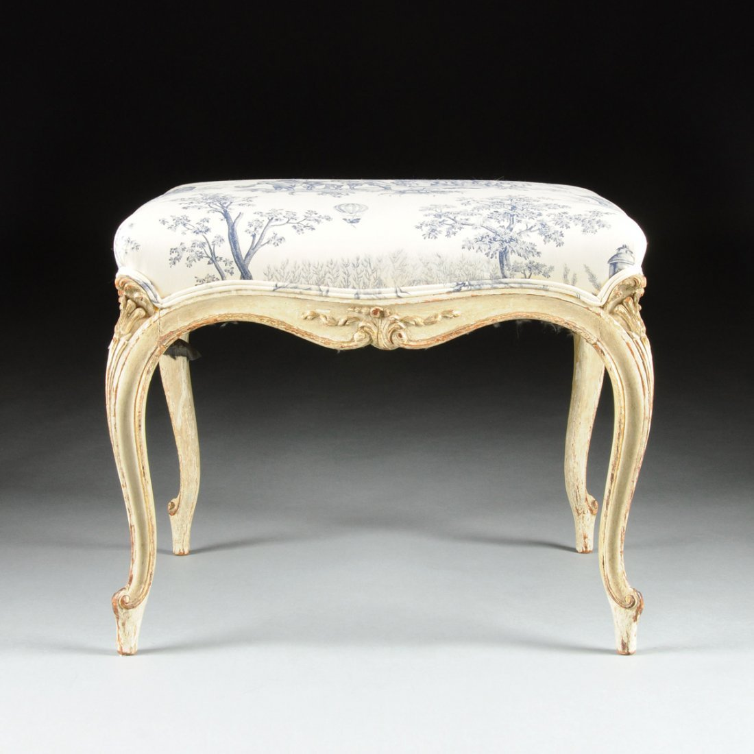A LOUIS XV STYLE PARCEL GILT AND WHITE PAINTED CARVED