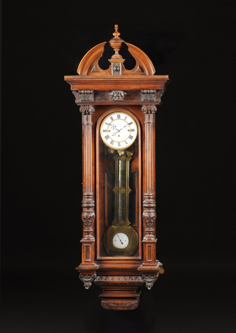 A RENAISSANCE REVIVAL CARVED WALNUT WALL CLOCK,