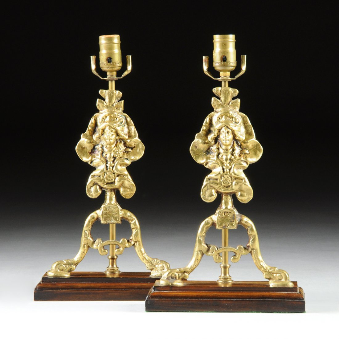 A PAIR OF REGENCE REVIVAL POLISHED BRASS CHENET FORM
