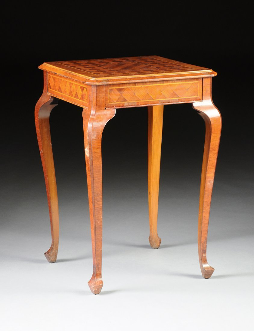 A CONTINENTAL WALNUT AND OLIVE WOOD INLAID PARQUETRY