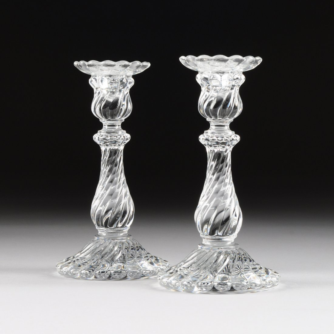 A PAIR OF BACCARAT MOLDED CLEAR CRYSTAL CANDLESTICKS,