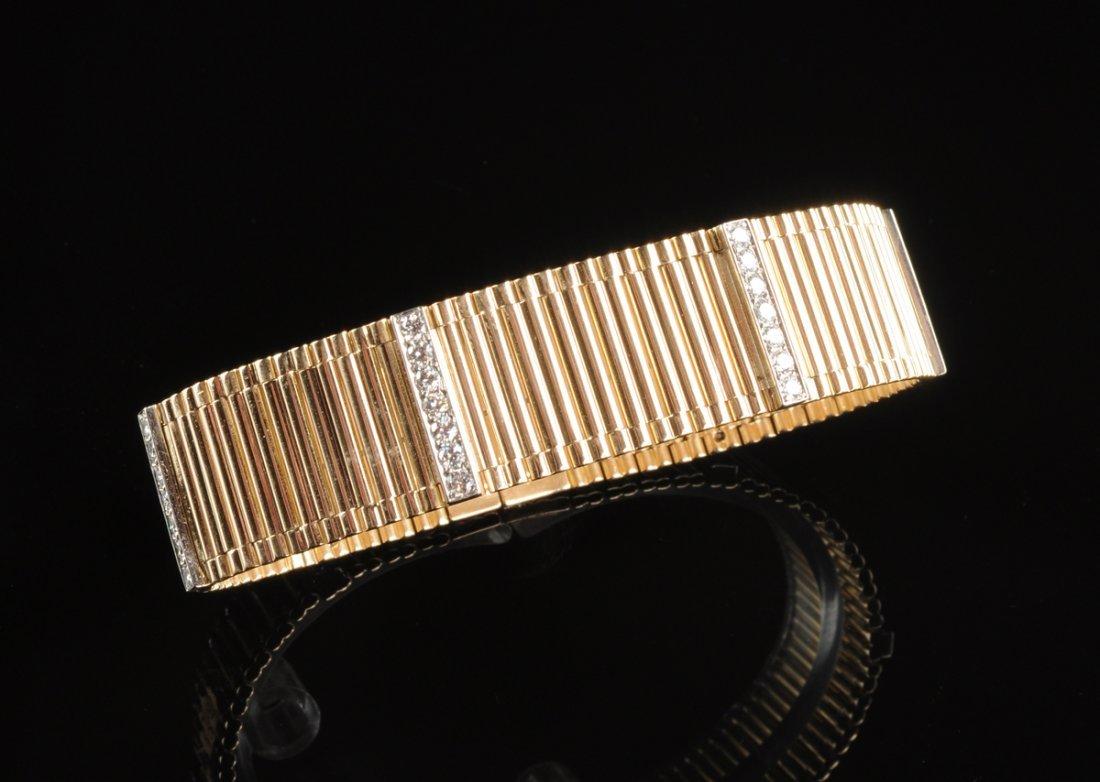 A 14K YELLOW GOLD AND DIAMOND LADY'S BRACELET,