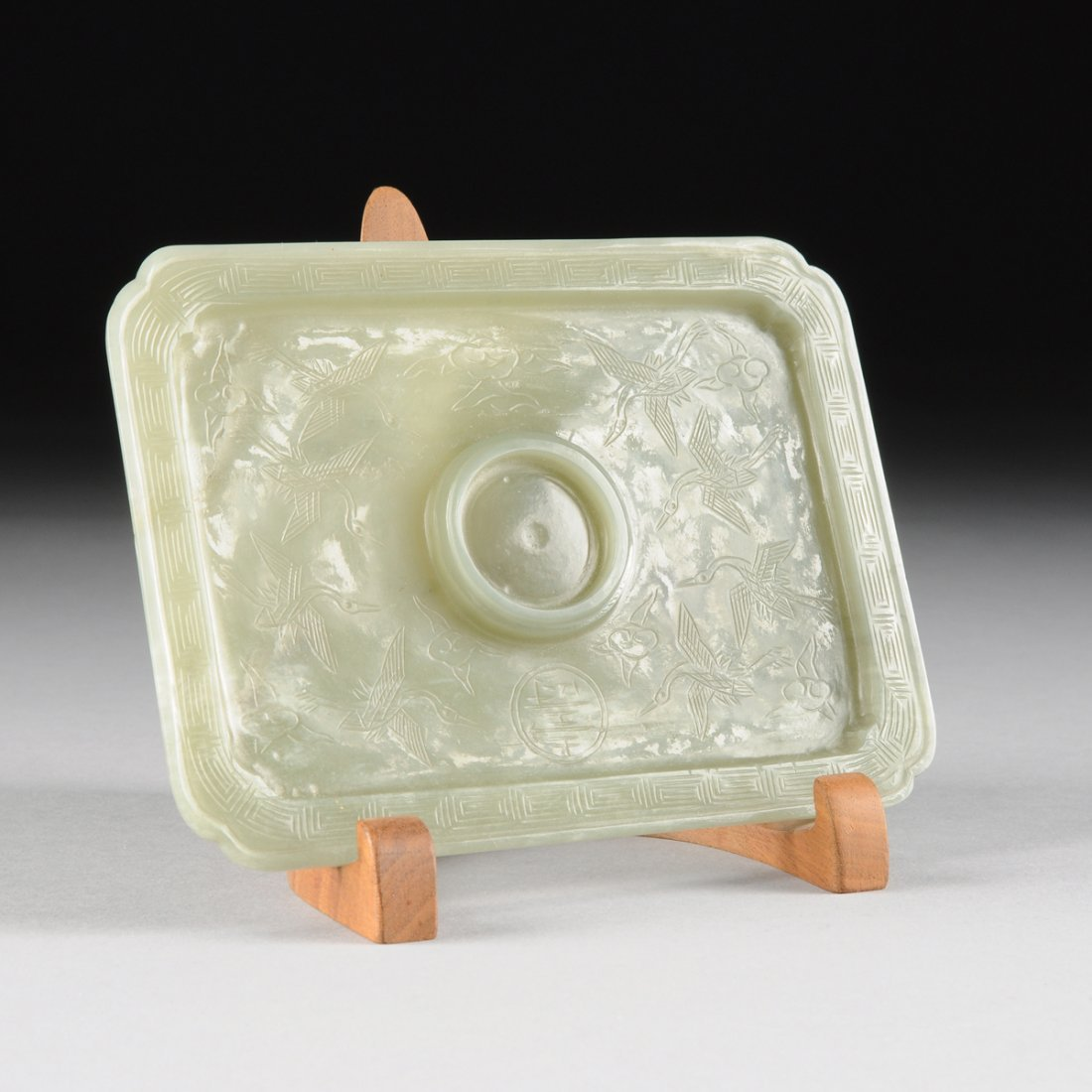 A DIMINUTIVE CHINESE CARVED AND INCISED CELADON JADE