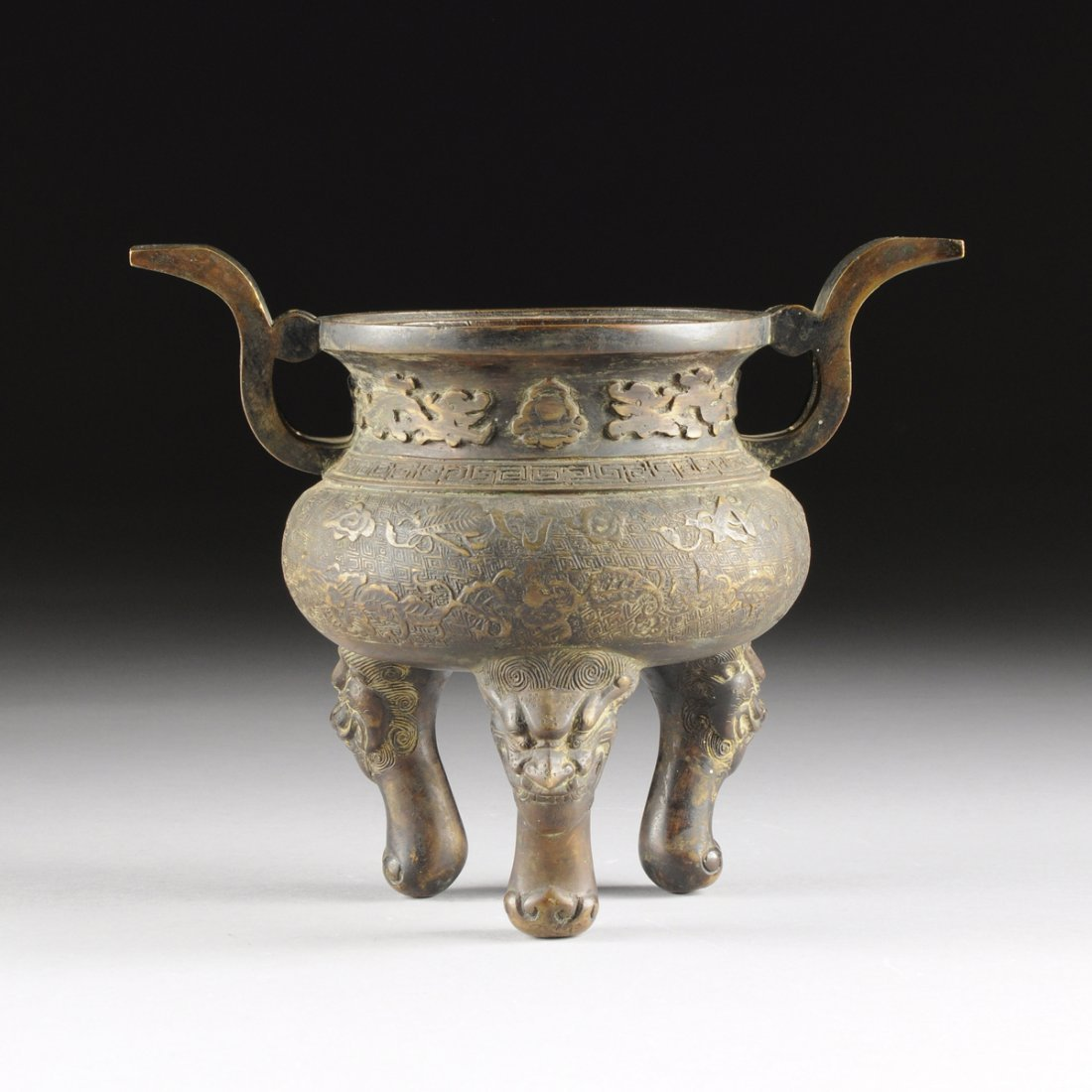 A CHINESE ARCHAISTIC STYLE PATINATED BRONZE DING, LATE