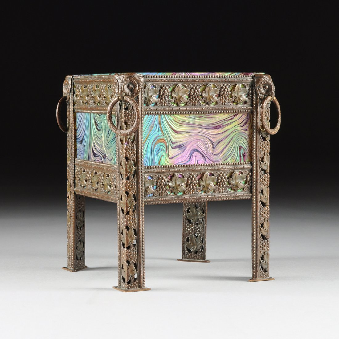 A VIENNA SECESSIONIST STYLE PATINATED REPOUSSE BRONZE