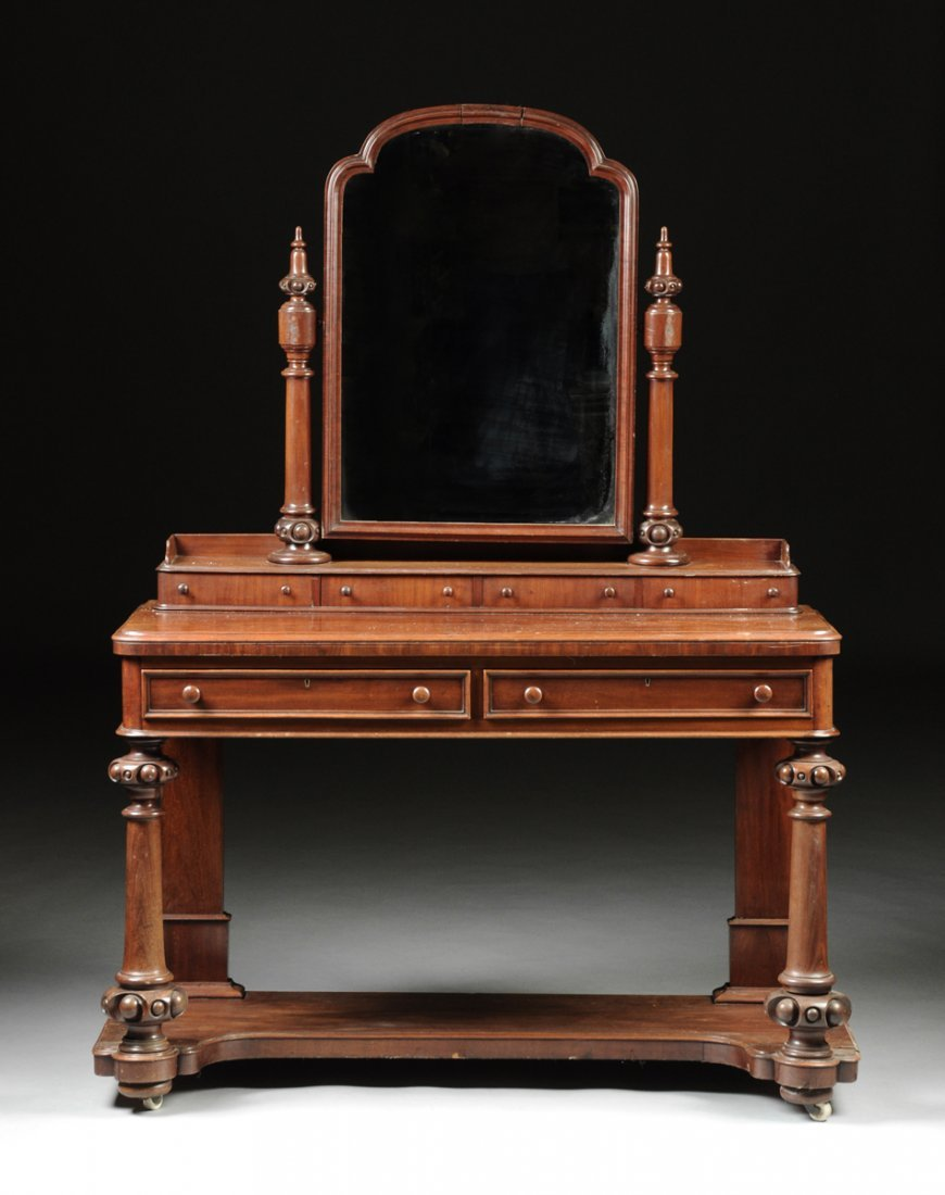 A VICTORIAN CARVED MAHOGANY DRESSING TABLE, LATE 19TH