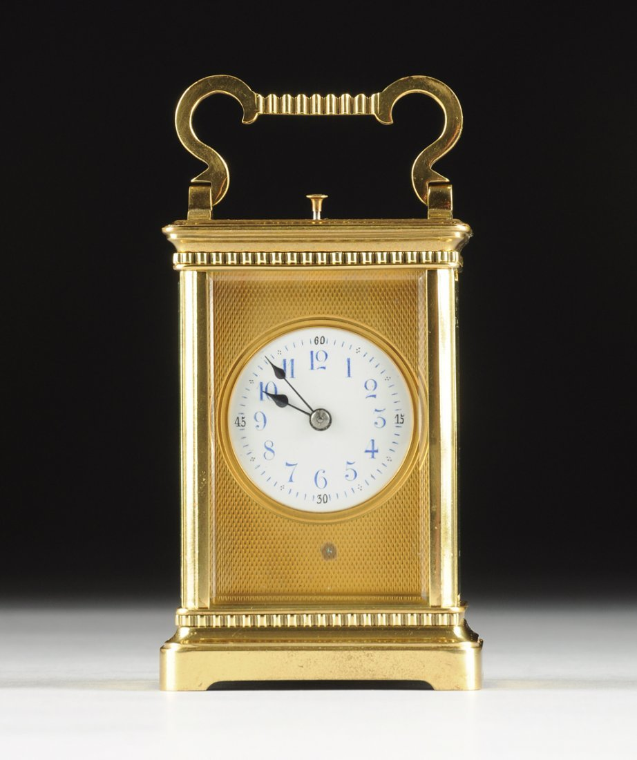 A POLISHED BRASS CARRIAGE CLOCK, POSSIBLY FRENCH, LATE