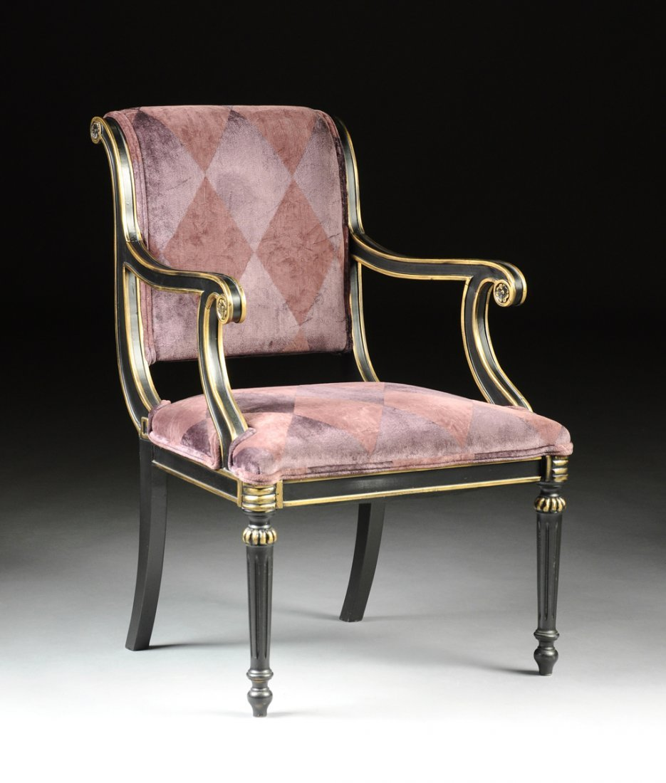 A NEOCLASSICAL STYLE EBONIZED AND PARCEL GILT