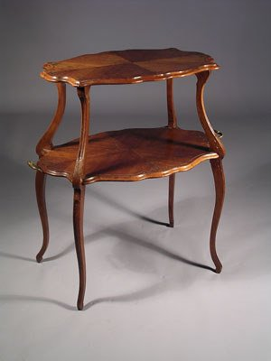 1: An antique two tier center table, the shaped carved