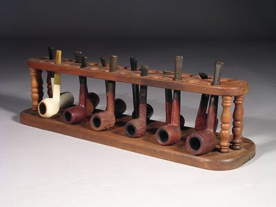 10: A collection of twelve pipes, on carved wood presen