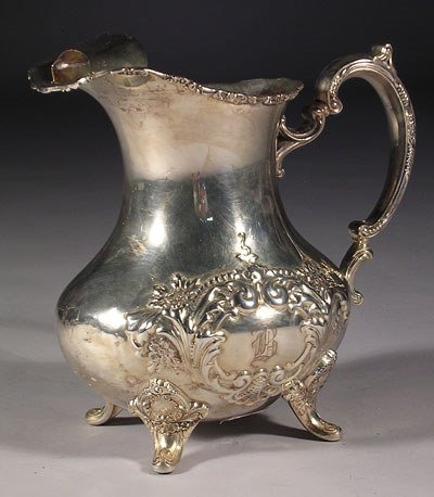 12: An English silver plated water pitcher by Bode with