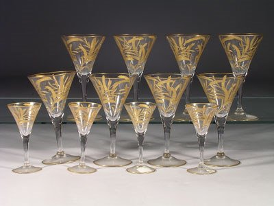 13: A service of eleven crystal wine goblets, each of t