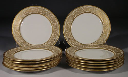 15: A service of twelve Limoges  luncheon plates made f