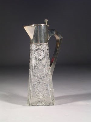 23: An antique cut crystal and silver plated mounted ca