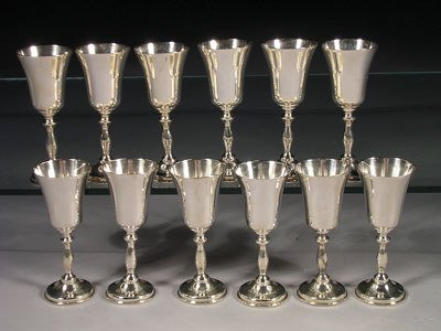 24: A service of twelve Queen Anne style sterling silve