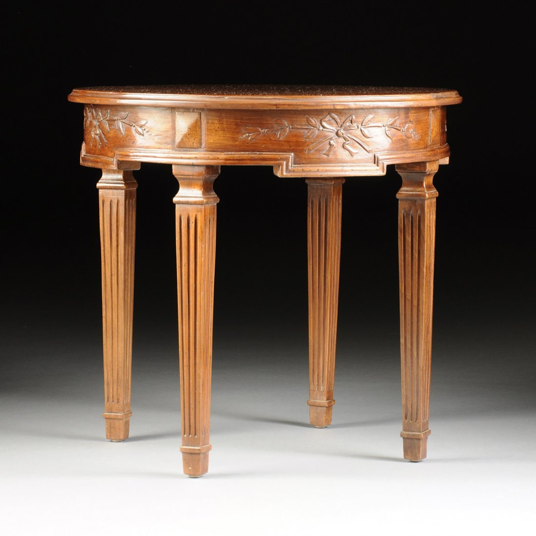 AN ITALIAN NEOCLASSICAL STYLE CARVED WALNUT OCCASIONAL