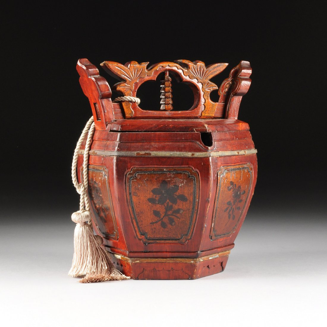 A CHINESE HEXAGONAL RED LACQUERED ELMWOOD TEAPOT