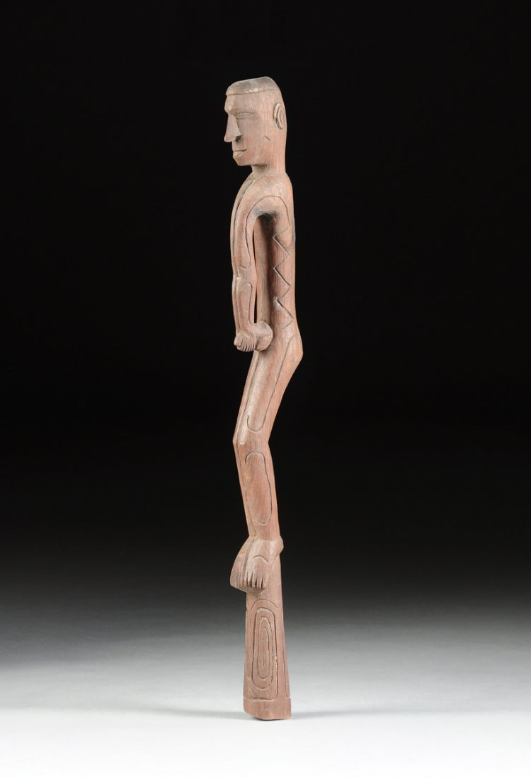 AN INDONESIAN TRIBAL CARVED WOOD ANCESTRAL MALE FIGURAL
