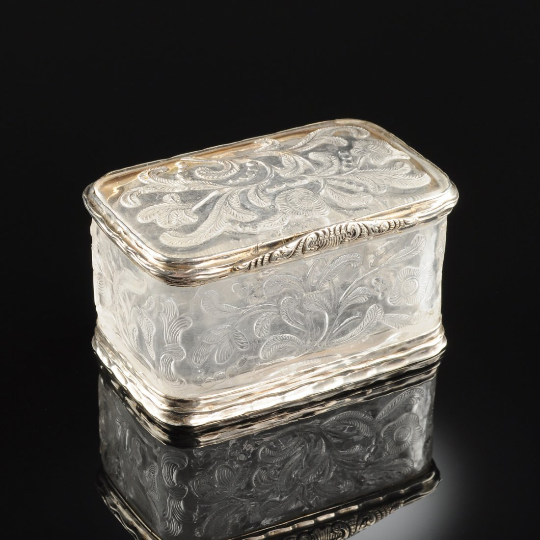 A CONTINENTAL SILVER METAL MOUNTED CARVED ROCK CRYSTAL