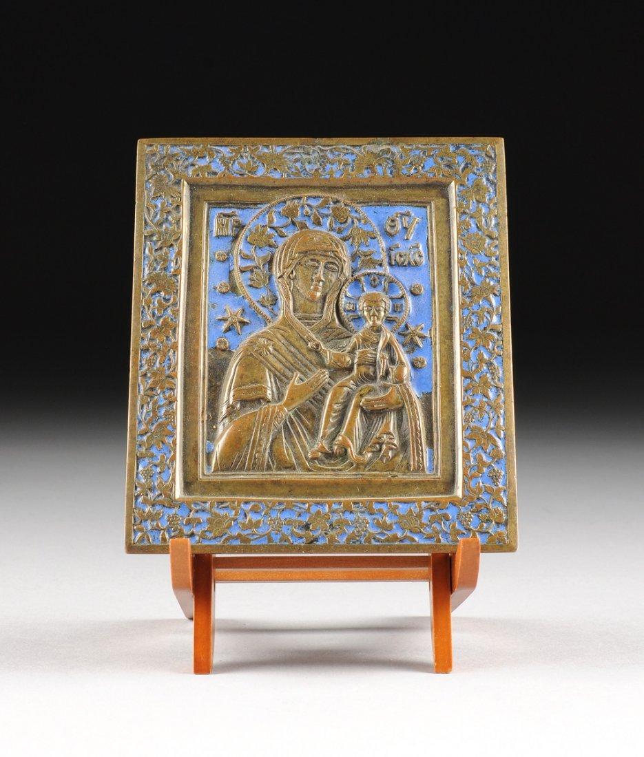 A RUSSIAN BRONZE AND ENAMEL ICON OF THE VIRGIN OF