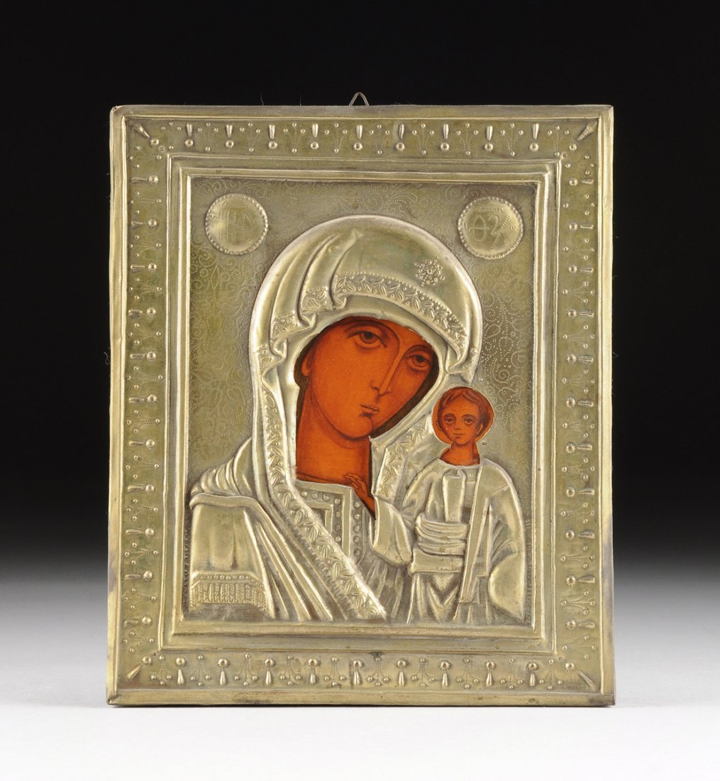 A RUSSIAN BRASS OKLAD MOUNTED ICON OF THE MOTHER OF GOD