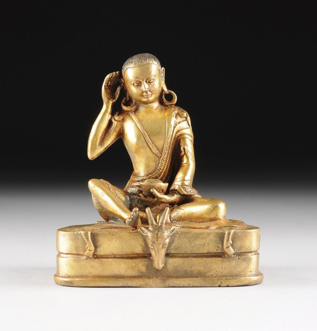 A TIBETAN GILT BRONZE FIGURE OF A BUDDHISTIC DEITY,