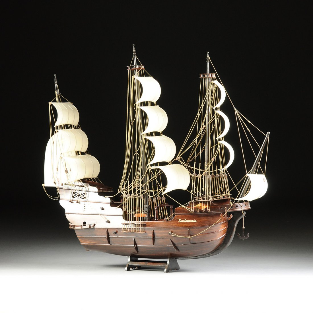 A SPANISH STYLE THREE MASTED CARVED AND STAINED WOOD