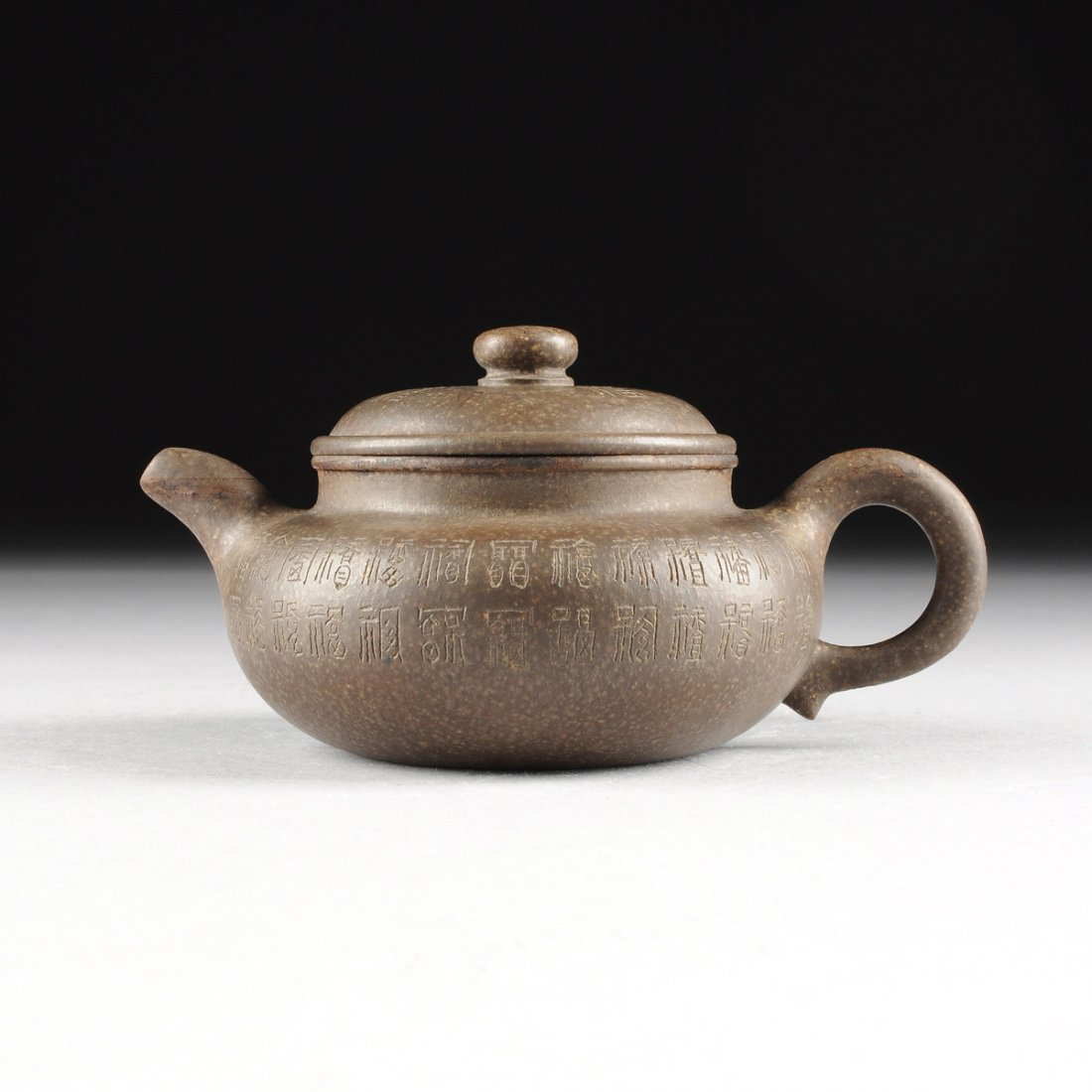A CHINESE YIXING ZHISA BROWN CERAMIC TEAPOT, IMPRESSED
