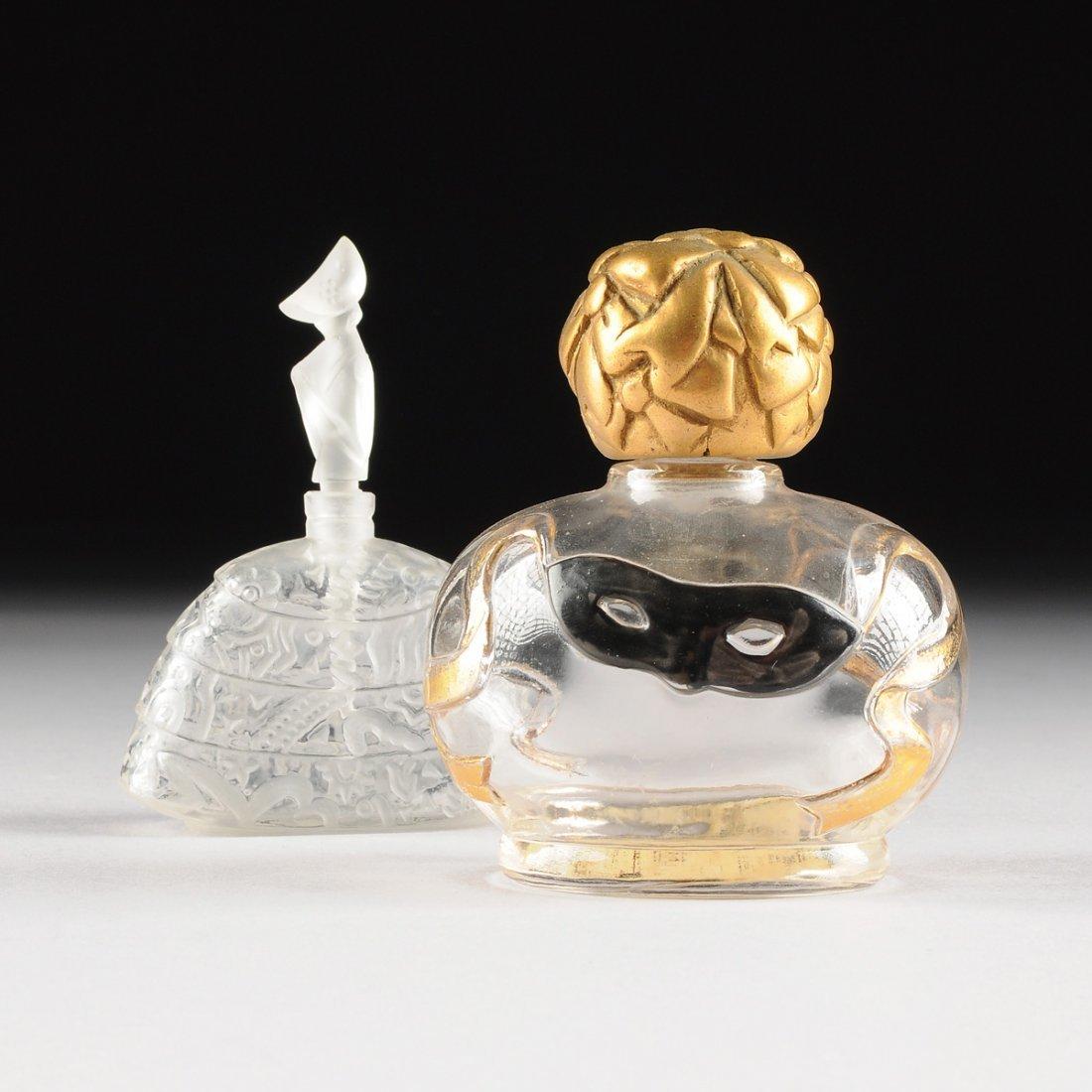 TWO VINTAGE GLASS DESIGNER PERFUME BOTTLES, CIRCA FIRST