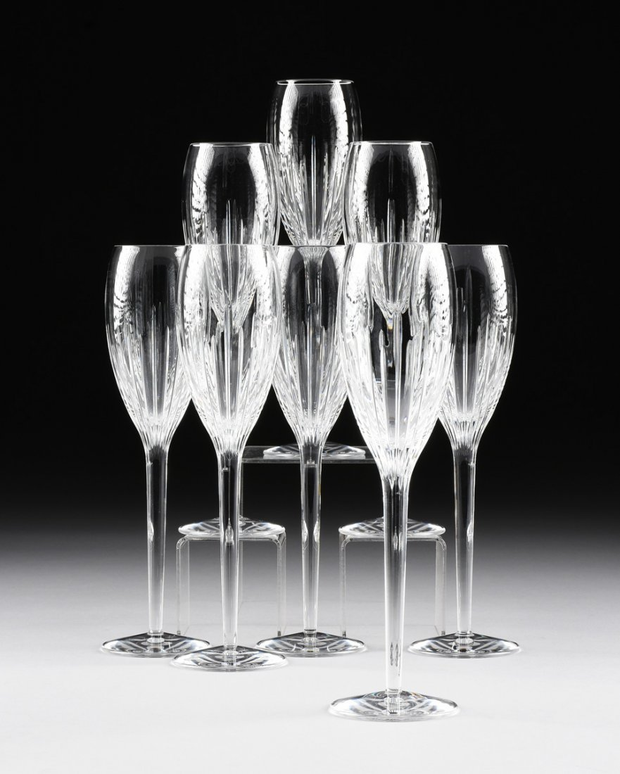 A SET OF EIGHT WATERFORD CUT CRYSTAL CHAMPAGNE FLUTES,