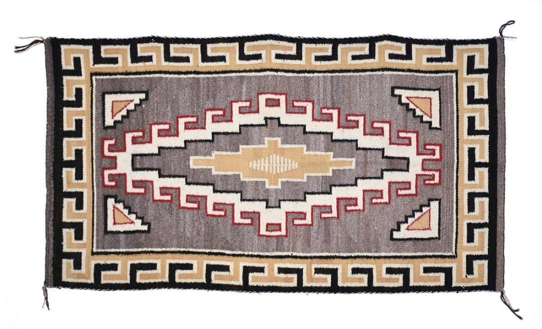 A NATIVE AMERICAN POLYCHROME WOVEN WOOL RUG, 20TH