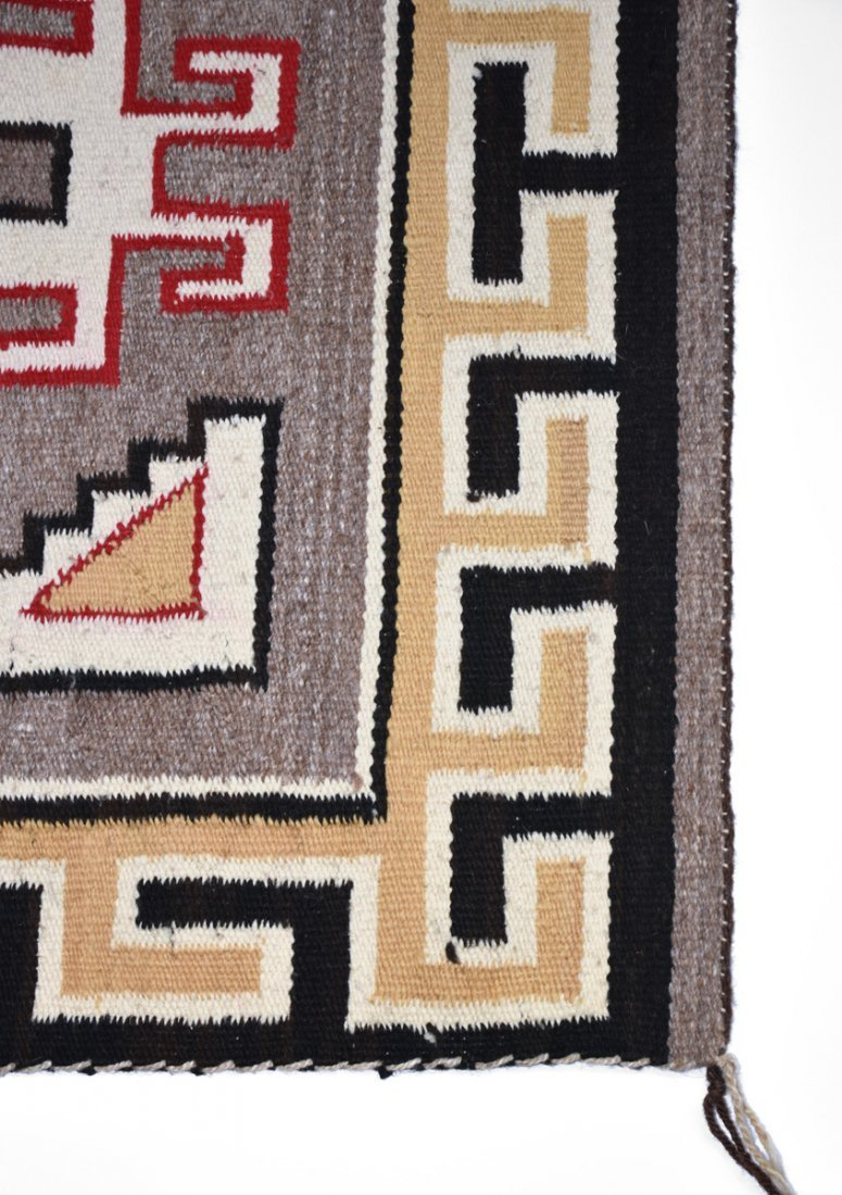 A NATIVE AMERICAN POLYCHROME WOVEN WOOL RUG, 20TH - 2