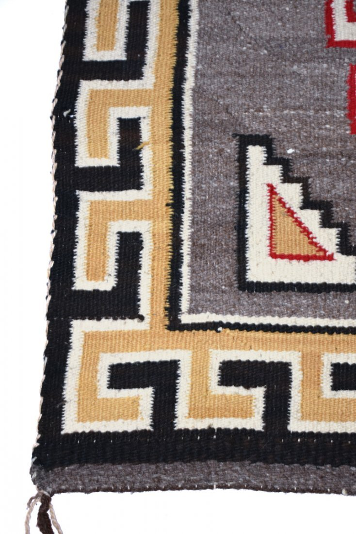 A NATIVE AMERICAN POLYCHROME WOVEN WOOL RUG, 20TH - 4